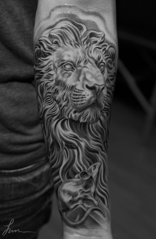 black & white lion tattoo on arm