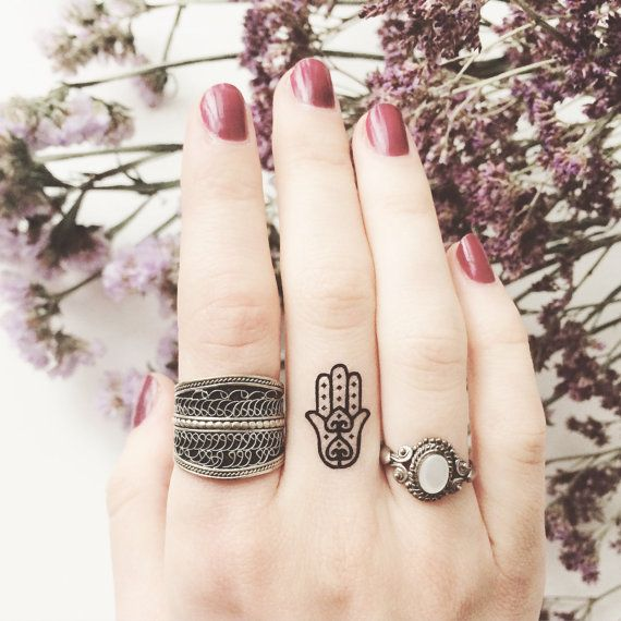 cute hamsa tattoo on finger @ 33