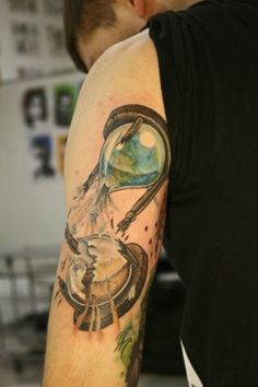 fabulous hourglass tattoo ideas on arm in green color