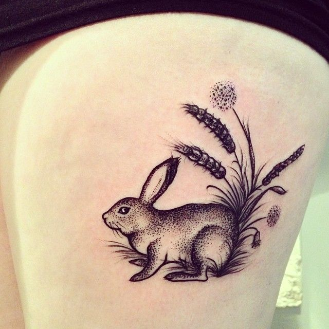 gorgeous rabbit tattoo on thigh