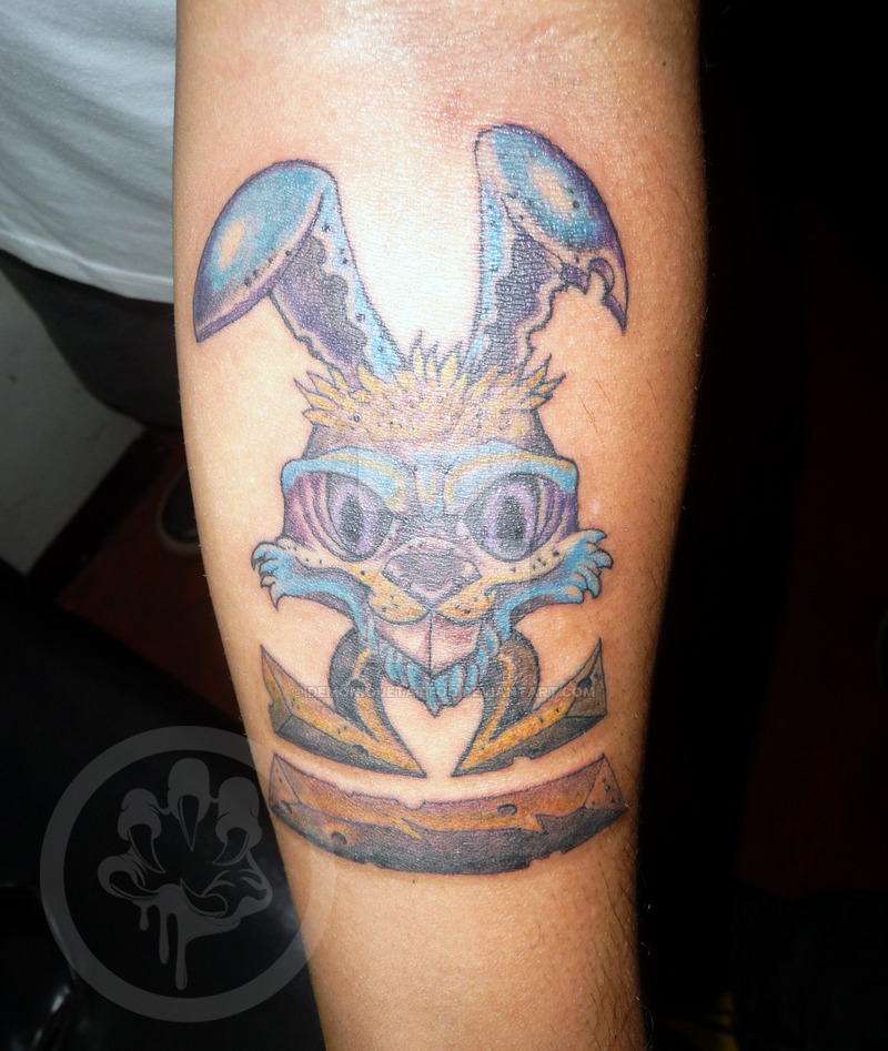 horrible colored rabbit tattoo on arm