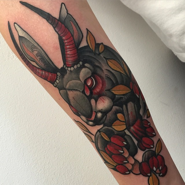 horrible evil rabbit tattoo on arm colored