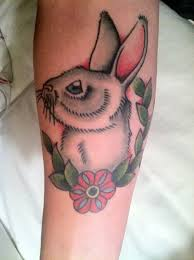 pink girly rabbit tattoo on arm