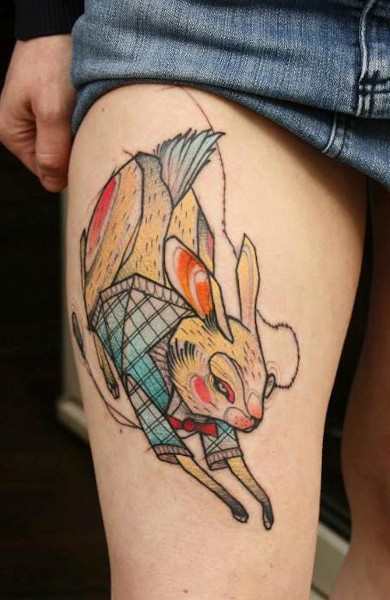 running rabbit tattoo on thigh