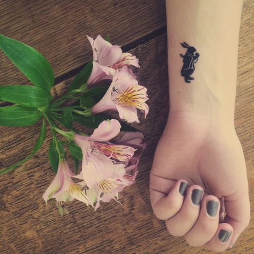 small black bunny tattoo on wrist for girls
