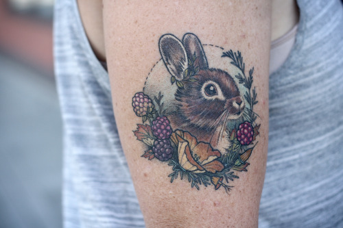 small colorful rabbit tattoo on arm