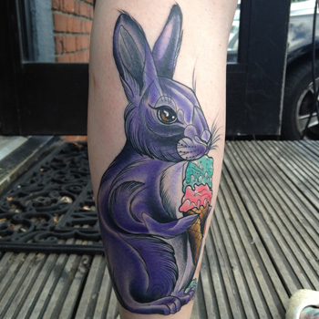superb rabbit tattoo with colored carrot