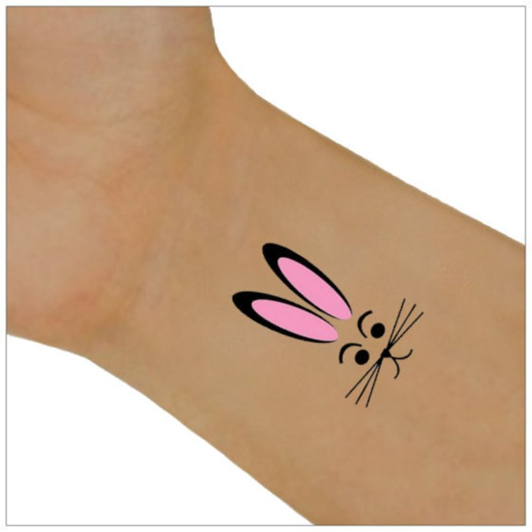 sweet rabbit tattoo in pick on wrist