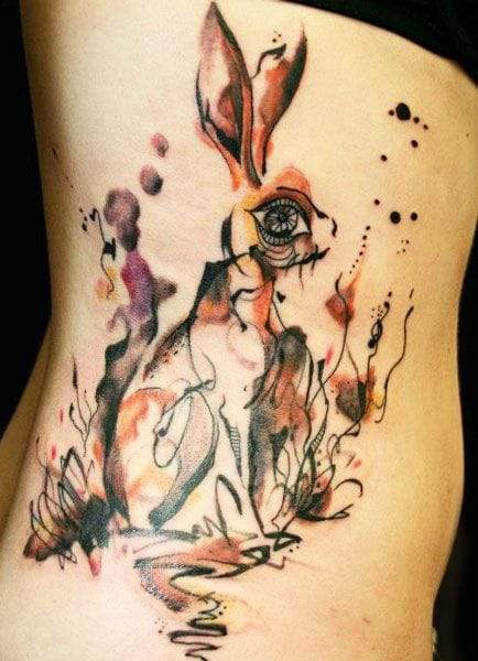 watercolor rabbit tattoo on rins for girls