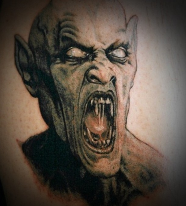 Dangerous devil tattoo with ugly eyes