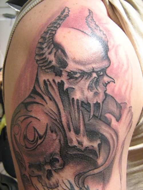 Extremely haunted devil tattoo to make everybody scary