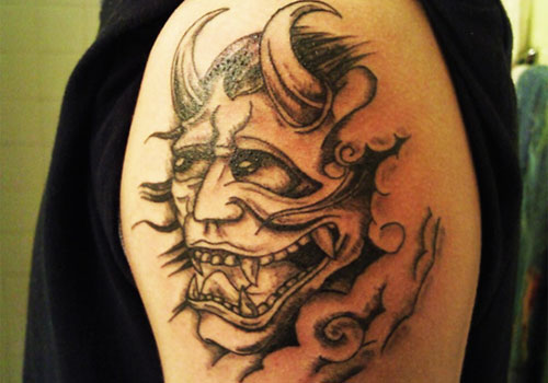 Haunted Devil tattoo on arm inked brown
