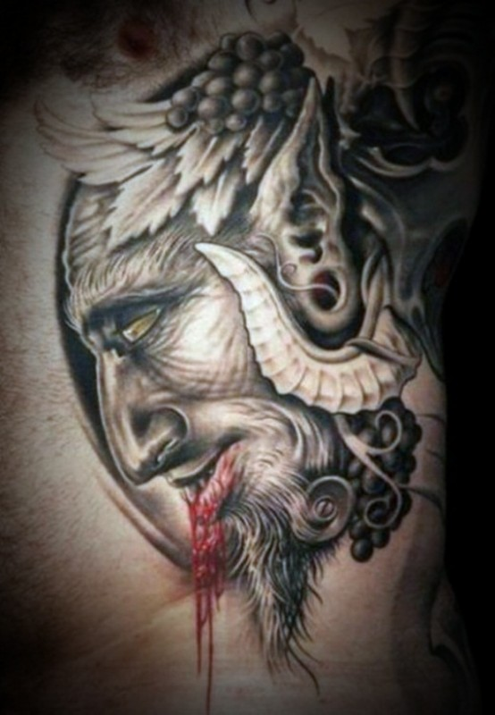 Horrible demon tattoo with blood on toung