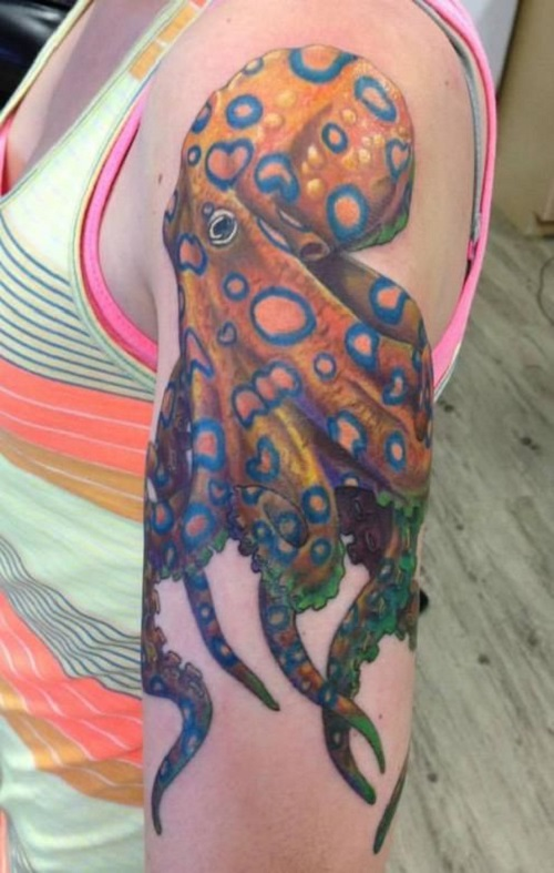 Meaningful octopus tattoo on forearm colored orange and blue