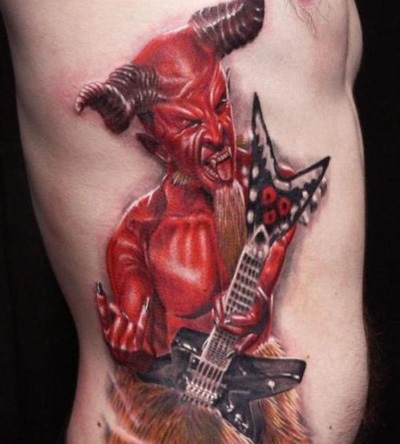Ugly devil tattoo inked red showing gitar