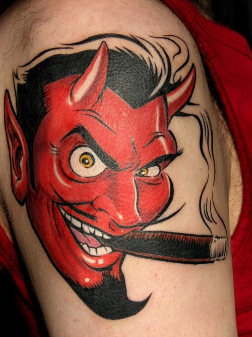 addictive devil tattoo creating smoke inked red on arm