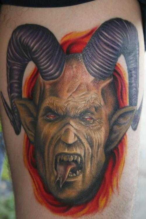 creative devil tattoo with horn will make you feel scary
