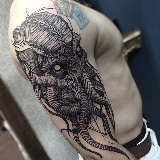 creative octopus tattoo for upperarm to get manly look