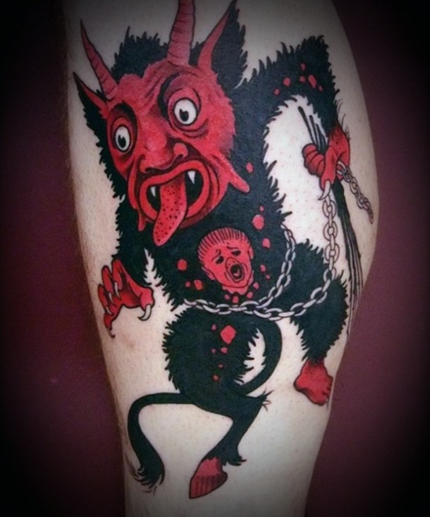 creepy monster tattoo with terror in eyes inked red