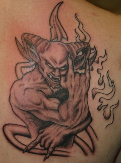 extremely scary demon tattoo on back