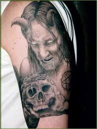 gothic tattoo on arm with cold eye and horns