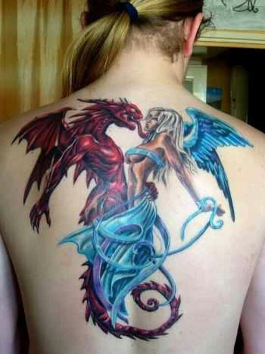 horrific creature tattoo on back inked in color